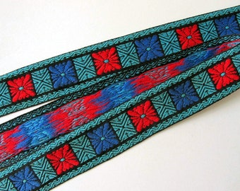 GEOMETRIC BURST Jacquard trim in red, blue, turquoise teal on black. Sold by the yard, 1 3/8 inch wide. V2020-A