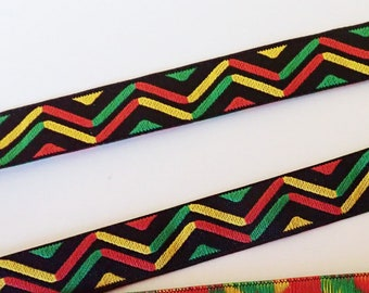 MASAI Jacquard trim in orange, red, yellow green on black. Sold by the yard. 5/8 inch wide. 999-A African trim