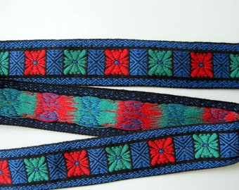 GEOMETRIC BURST Jacquard trim in red, green, blue on black. Sold by the yard. 1 3/8 inch wide. V2020-B