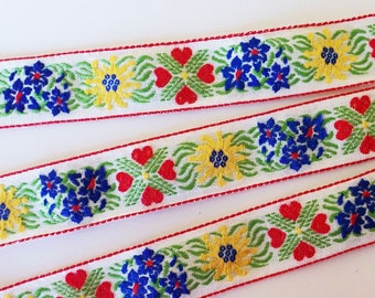 EDELWEISS & HEARTS Jacquard trim in yellow, blue, red, green on white. Sold by the yard. 1 inch wide. V2773-C Bavarian trim