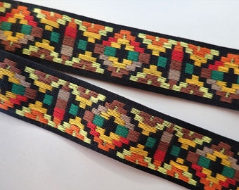 MESKWAKI Jacquard trim in orange, yellow, tan, red, green on black. Sold by the yard. 1 1/8 inch wide. 2096-A. Sunset hues