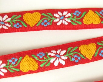 SWEDISH HEARTS Jacquard trim. White, yellow, blue, green, on red.  Sold by the yard. 3/4 inch wide. 2075-A Bavarian dress trim