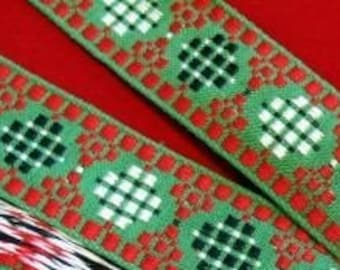 Red, Green CUBIC CIRCLES Jacquard trim, red, black, white, on green. Sold by the yard. 1 1/4 inches wide. V05-A. Christmas festive trim