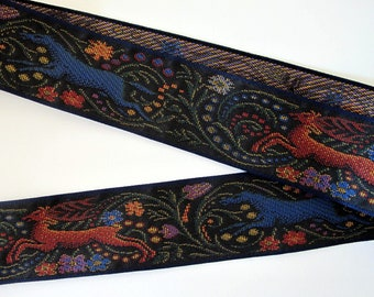 STAG and BLUE WOLF Jacquard strap in bronze, blue, purple, yellow on black. Navy edges. 2 1/4 inches wide. 2093-A. Middle Age tapestry