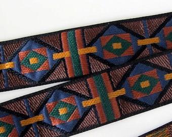 ARIZONA Jacquard trim in mustard, tan, blue, green on black. Sold by the yard. 1 inch wide. 2030-A Geometric trim