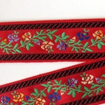 BAVARIAN FLORAL GARLAND Jacquard trim. Yellow, blue, green, black on red. Sold by the yard. 1 1/4 inch wide. 2034-A Bavarian dress trim