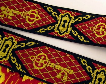 LOCK and KEY Jacquard trim in ox blood red, golden yellow on black. Sold by the yard. 7/8 inch wide. 932-a Steampunk Dieselpunk trim