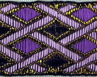 PHINEAS Jacquard trim with Mauve and  metallic gold cross hatching and Purple and Black diamonds. Sold by the yard. 1 1/2 inch wide. 2060-F