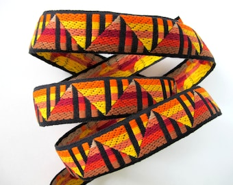 GIZA Jacquard trim in orange, yellow, burgundy, red, tan on black. Sold by the yard. 1 1/4 inch wide. 2094(2)-B Sunset on the pyramids