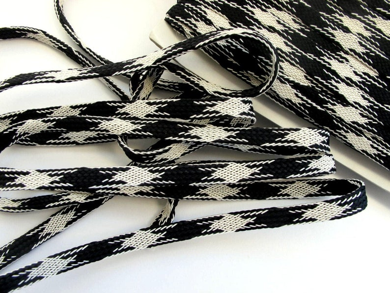 Black and Off White TUBE BRAIDED tape passementerie trim. Sold image 0