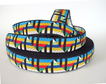 GIZA Jacquard trim in turquoise, yellow, red, green, white on black. Sold by the yard. 1 1/4 inch wide. 2094(2)-A Sunset on the pyramids