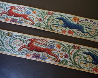 STAG and BLUE WOLF Jacquard strap, bronze, blue, purple, green, yellow on light grey. Beige edges. 2 1/4 inches wide. 2093-B. Middle Age