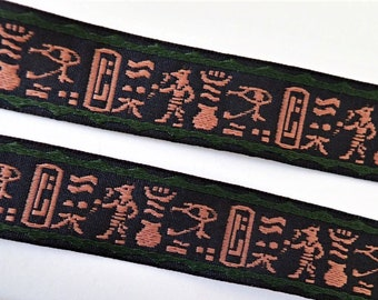 EGYPTIAN Jacquard trim in bige on black with green edges. Sold by the yard. 3/4 inch wide. 3000-A Bas relief, pyramids, tomb raider