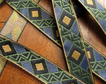 WARLORD Jacquard trim in mustard, slate blue, olive green, on black. Sold by the yard. 3/4 inch wide.851-B. A geometric trim
