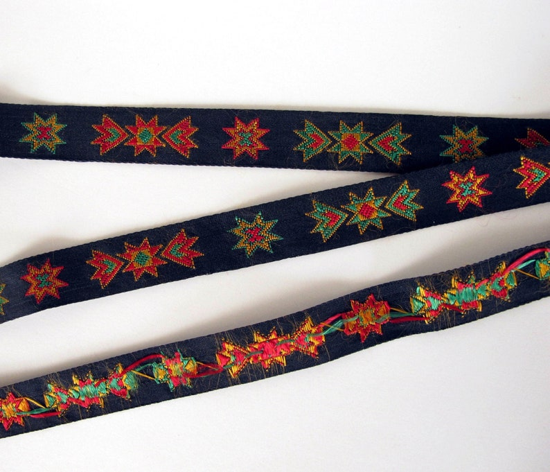 KICKAPOO Jacquard trim in red green yellow on black. Sold by image 0