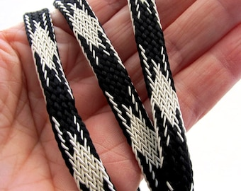 Black and Off White Tube Braided tape. Sold by the yard. 5/16 inch wide. 611-01 Woven tube braid, Hefty shoe lace braid