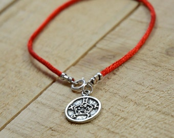 Safety Amulet on Red String Bracelet