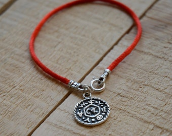 Livelihood Amulet on Red String