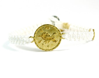 Unisex Brass Health Amulet Charm Bracelet and Signature MIZZE Button on White Parachute Chord