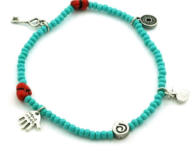 Turquoise colored Stretch Charms Anklet with natural Red Coral beads