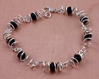 Spiral and Black Onyx Silver Bracelet