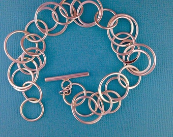 Multi -Ring Sterling Silver Bracelet