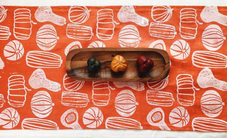orange pumpkins. block printed linen table runner. image 0