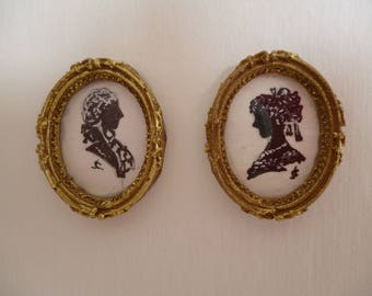 A pair of Hand painted Miniature Silhouettes in gold painted resin frames ,one 12th scale.