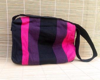 Stripy patchwork shoulder bag. Full zipper closure, two pockets. Pink, purple, black.