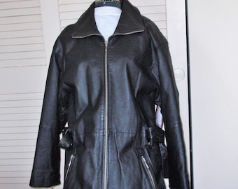 Black  Leather Jacket.Winlit ,New York. Wrap belt. Black Nylon,Quilted lining.Lots of Metal Zippers on sleeves and outer pokets.Preowned