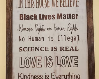 In this house we believe wooden sign