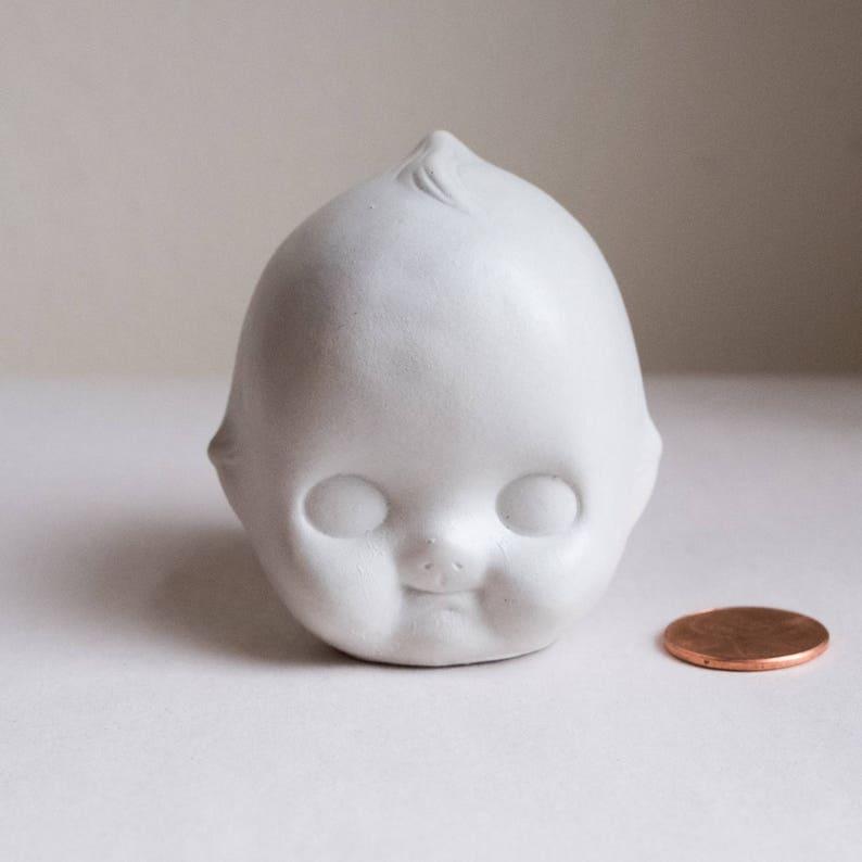 Mini Doll Head image 0