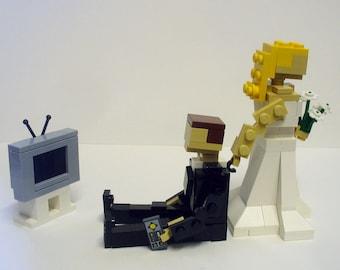 Custom Bride dragging Groom from TV Wedding Cake Topper
