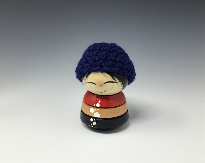 The Kokeshi with the  Blue hat