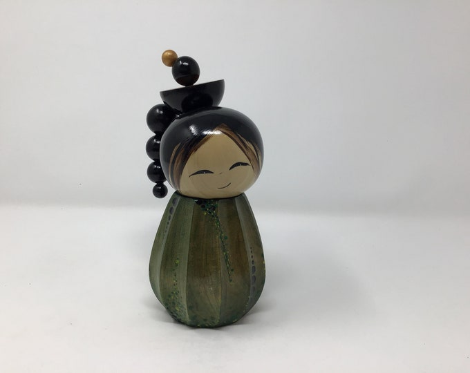 Fluted and carved kokeshi