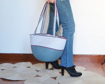 Rope basket bag. A great summer carry all beach handbag made of cotton rope and carefully design for a Mediterranean look and lifestyle.