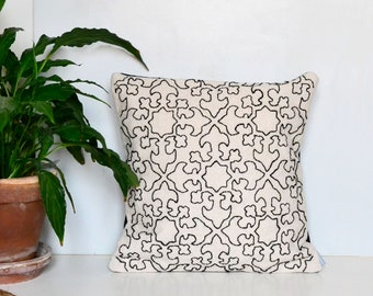 Modernist hand embroidery cushion cover. Grain sack cotton and black yarn