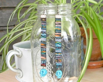 Hand Painted Leather Earrings with Skull Bead    Vivid colors on reclaimed leather scraps with silver plated stainless steel ear wire