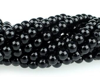 """Dakota Stones Onyx 4mm Round Gemstones. 8"""" Strand. ONX4RD-8"""