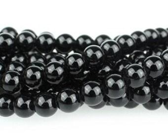 """Dakota Stones Onyx 6mm Round Gemstones. 8"""" Strand. ONX6RD-8"""