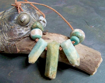 Aquamarine Spike Pendant   Rough Crystal on Braided Leather Necklace   Roman Glass and Old Turkomen Tribal Button Clasp   Neolithic Jewelry