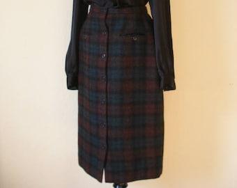 80s wool pencil skirt by Perry Ellis. Beautiful dark nubby wool plaid in greens and dark purply maroon'ish browns. Size S.
