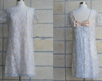 60s lace dress, flesh tone with metallic silver and nude lace overlay, giant pink satin bow on back and train, perfect mod bridal mini gown.
