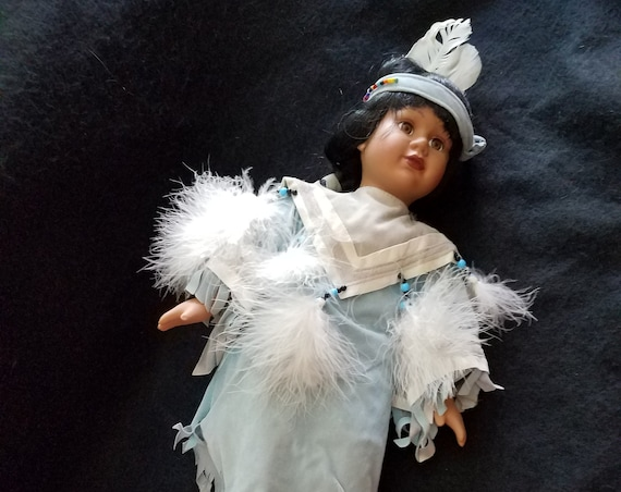 Native American Porcelain and Cloth Doll