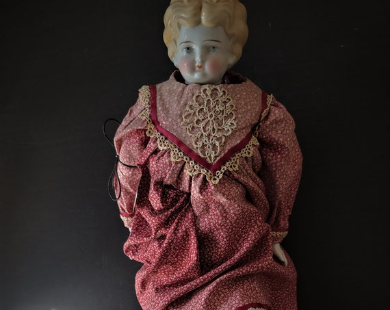 German Porcelain Low Brow Doll with Kid Leather Body circa 1890