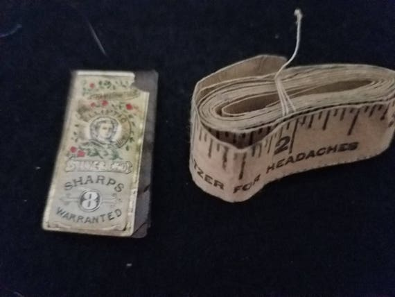 Antique Needles and Tape Measure