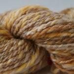75 yards tan handspun yarn, 2 oz.