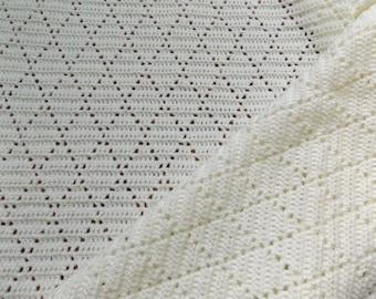 Crochet baby blanket in vintage diamond lace pattern