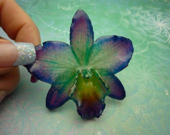 Real Orchid Flower Necklace - Teal/Purple/Natural. This is a REAL Orchid flower which has been preserved in resin making a unique necklace