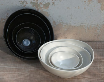 white porcelain nesting bowls. A set of 4 elegant serving bowls. Design and handmade by Wapa Studio.